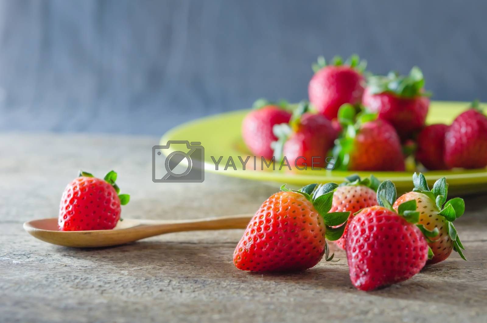 Royalty free image of  red strawberries on dish by rakratchada