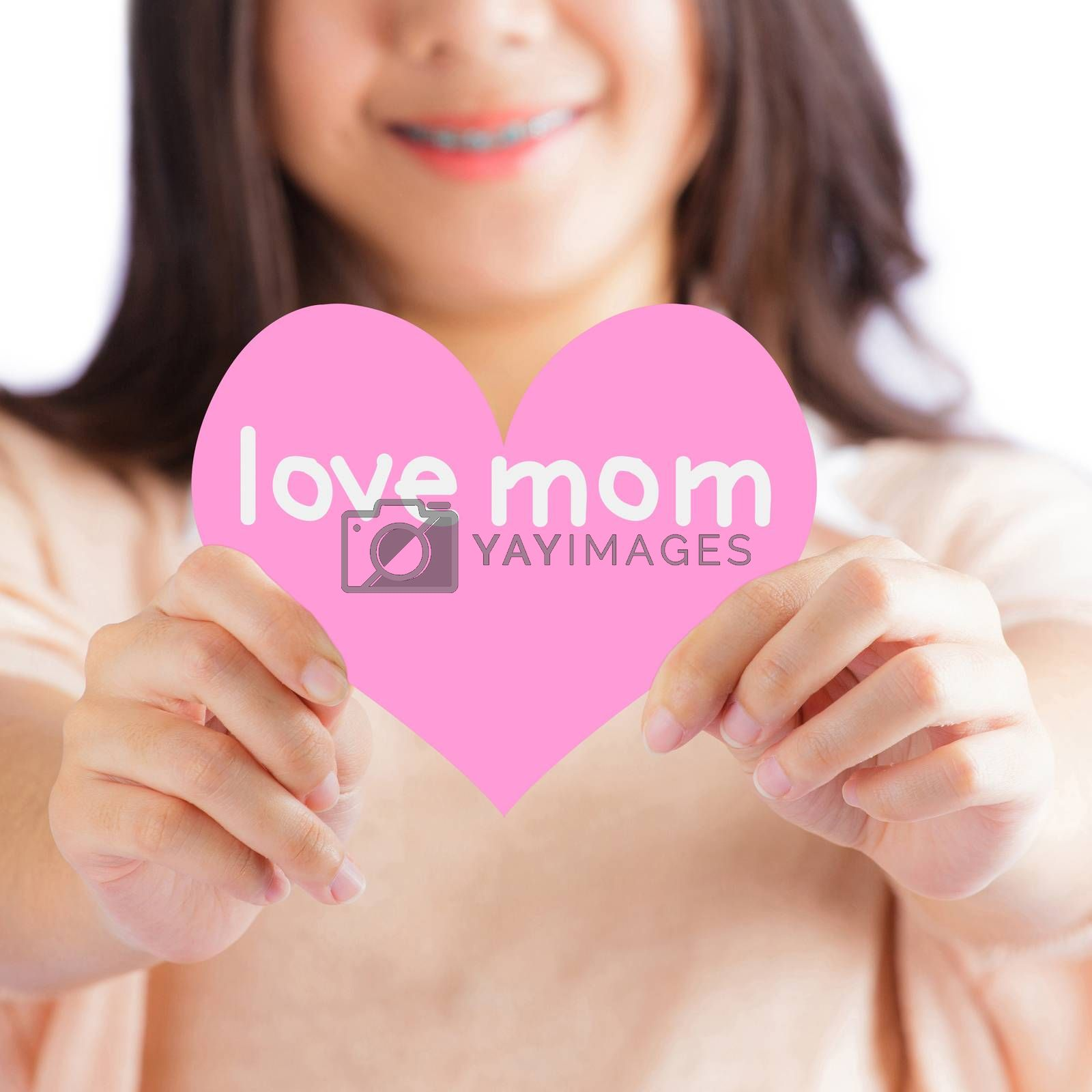 Woman holding pink heart with love mom