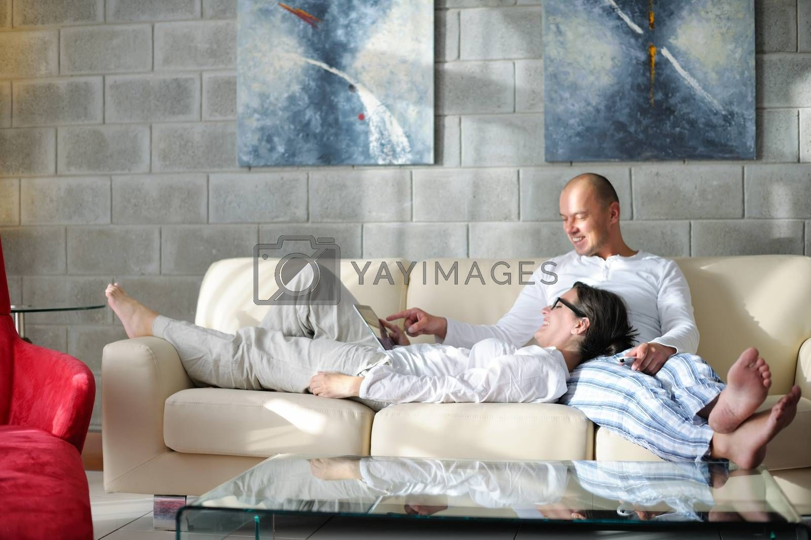 Royalty free image of young couple using tablet computer at home by .shock