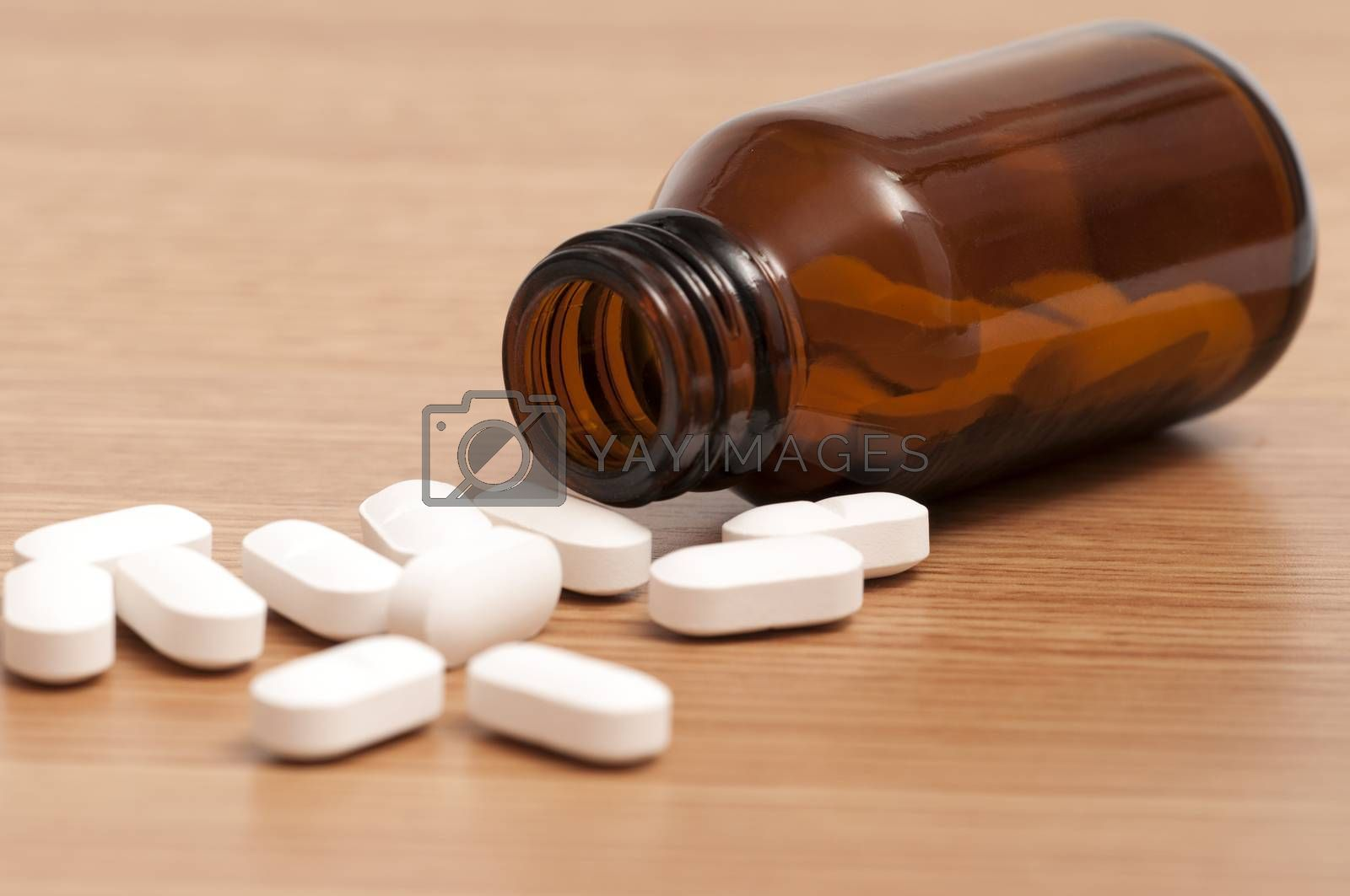 Royalty free image of Capsules and Pills in a bottle by rodrigobellizzi