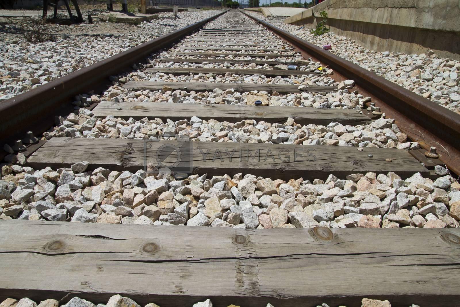 Royalty free image of train rails, detail of railways in Spain by FernandoCortes