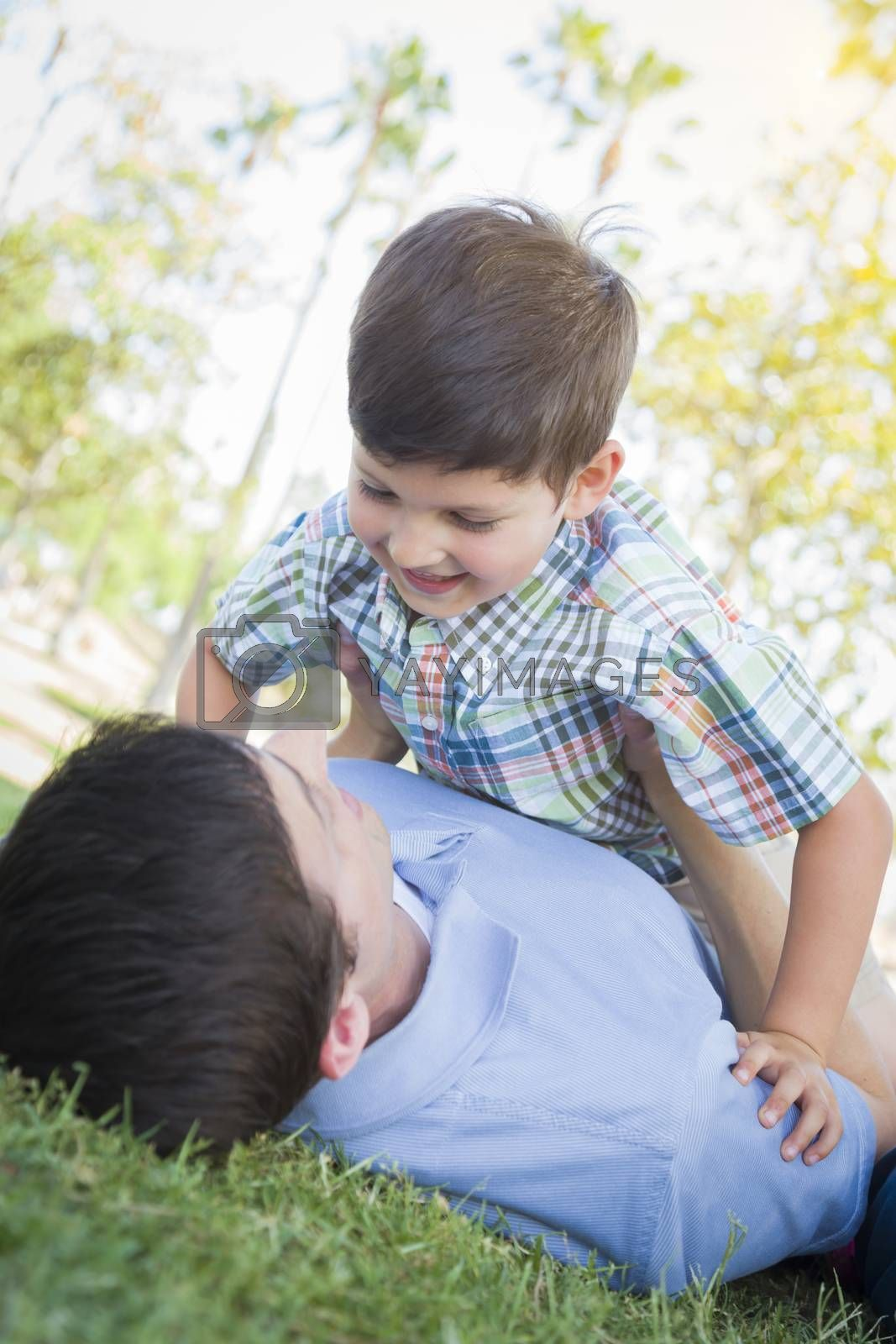Royalty free image of Father and Son Playing Together in the Park by Feverpitched