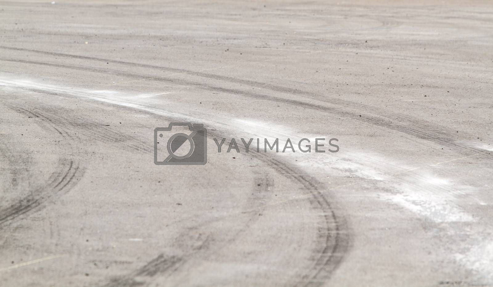 Royalty free image of Tire marks on road track by liewluck