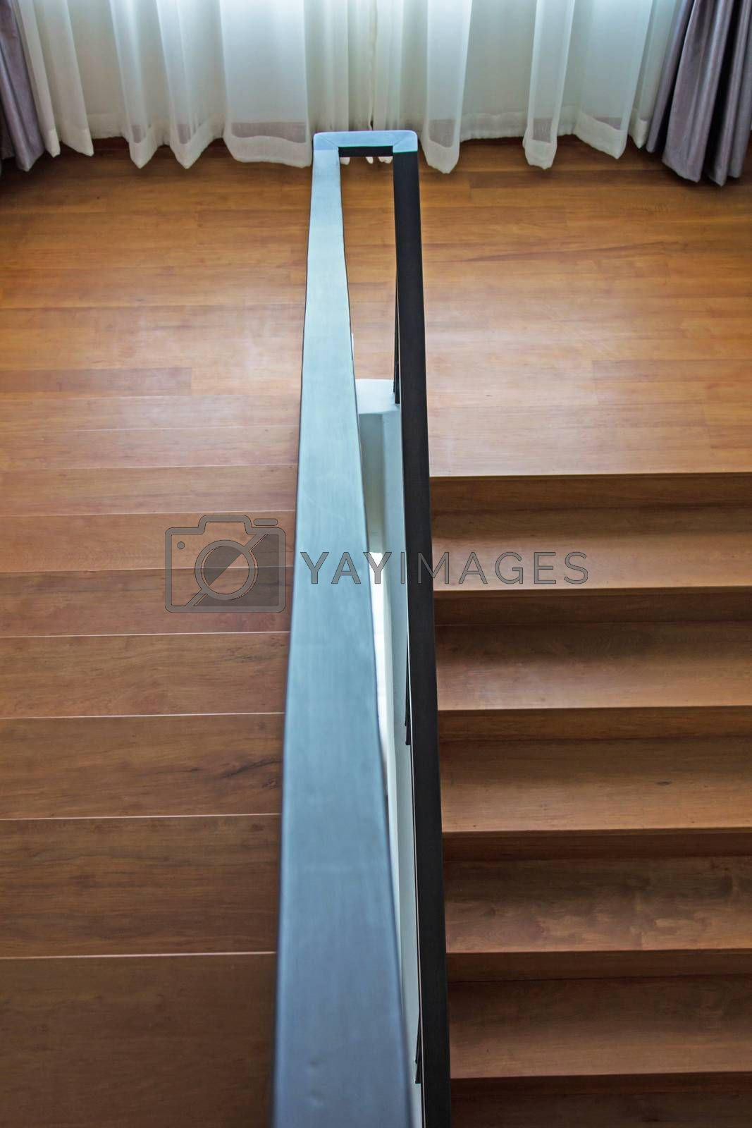 Royalty free image of Staircase with wooden steps by liewluck