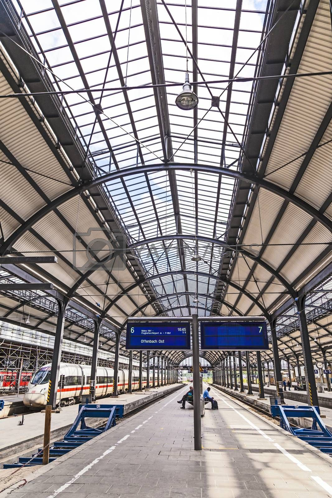 Royalty free image of people wait at iron classicistic train station in Wiesbaden by meinzahn