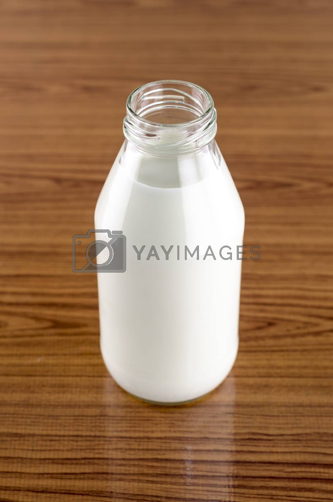 Royalty free image of milk in a glass of bottle by ammza12