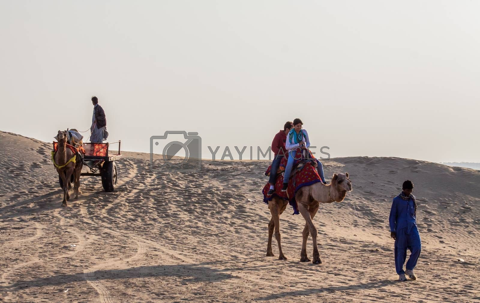 Royalty free image of Sam Sanddunes, Jaisalmer, Rajasthan, India.16February2014.Camel Rides and camel cart with unknown tourists by giddavr