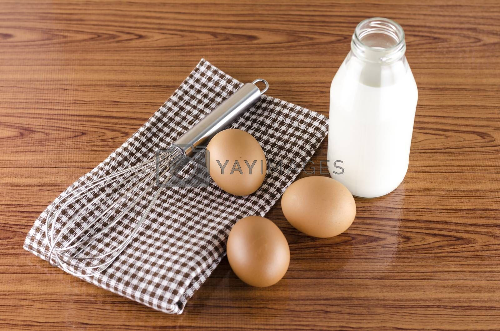 Royalty free image of whisk egg and milk by ammza12