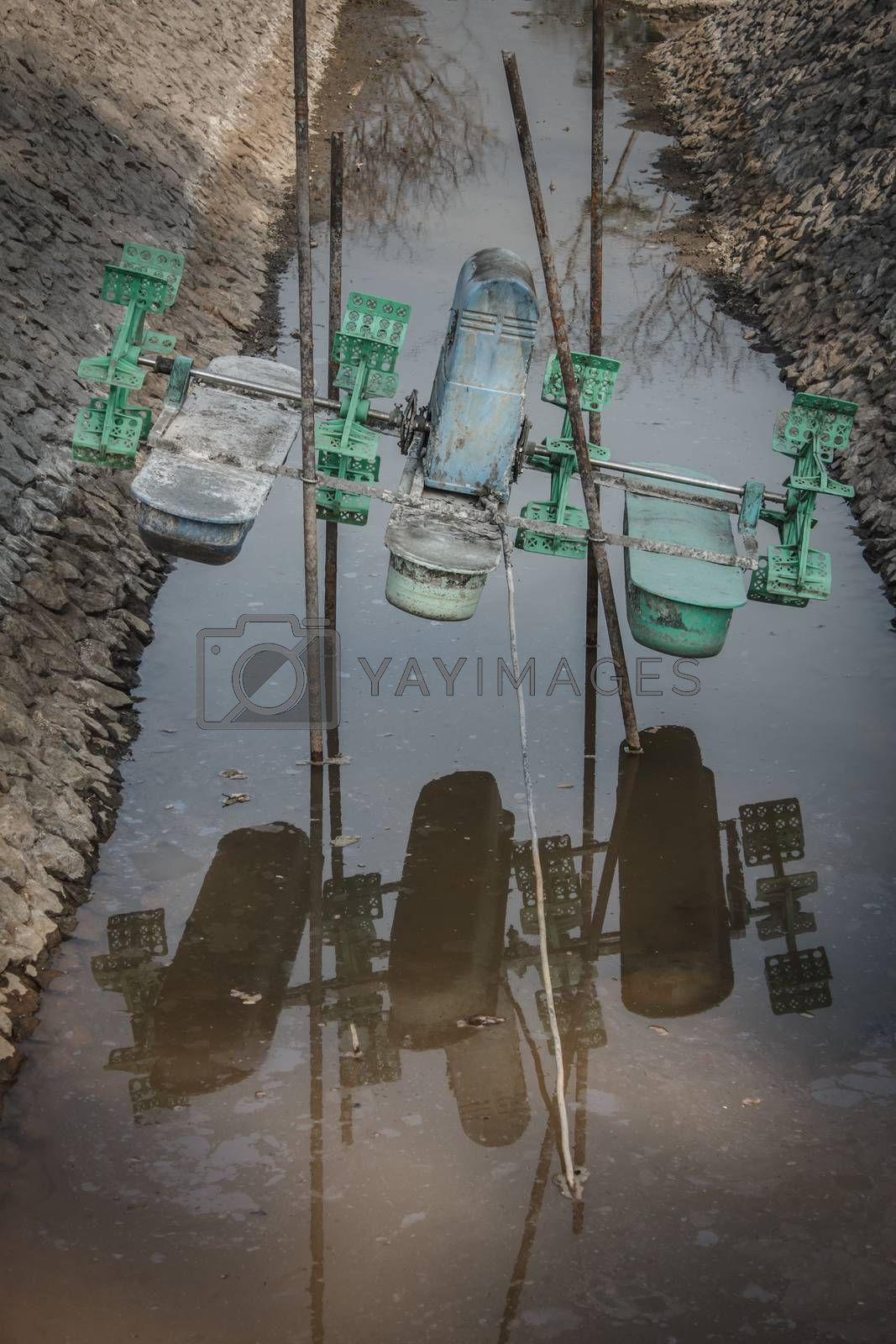 Royalty free image of water wheel without water by letoakin