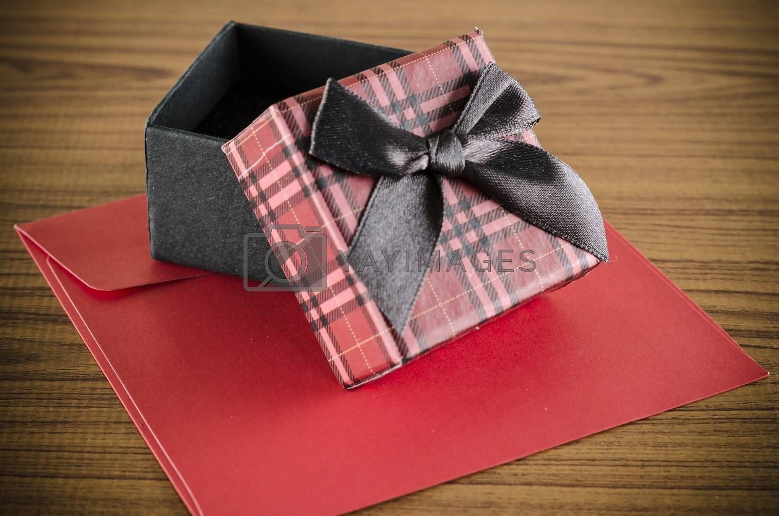 Royalty free image of red gift box and envelope by ammza12