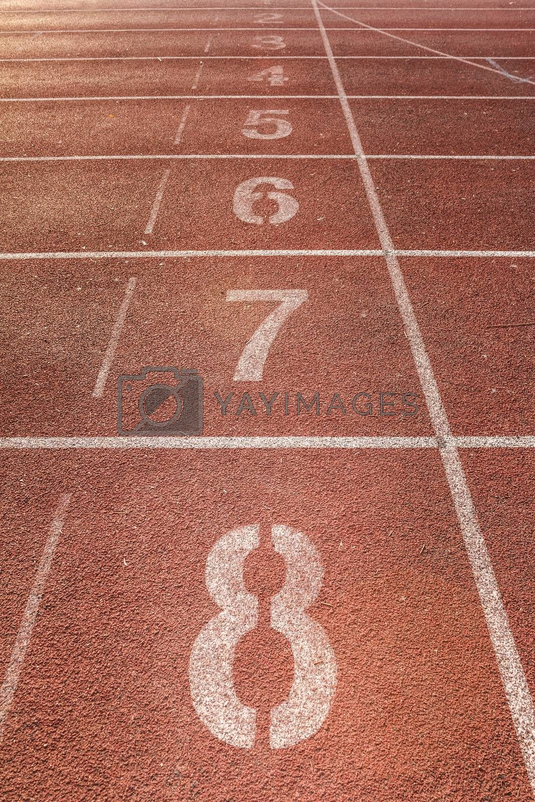 Royalty free image of number on running track by letoakin