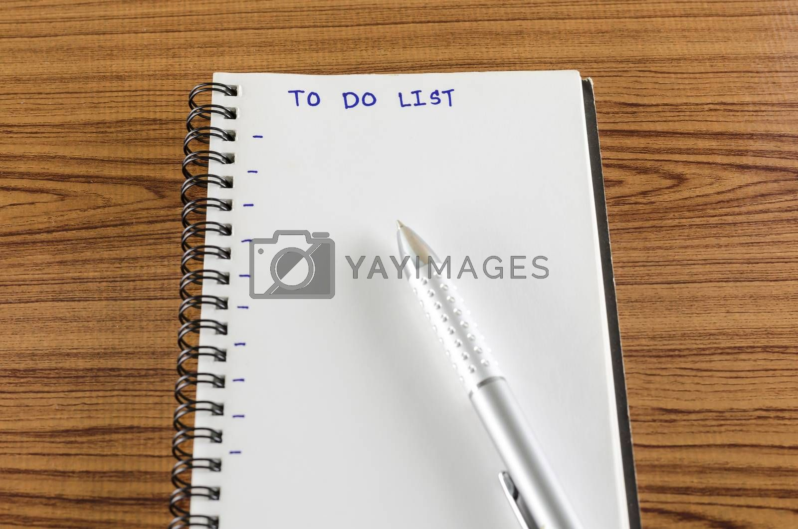 Royalty free image of notebook and pen with word to do list by ammza12