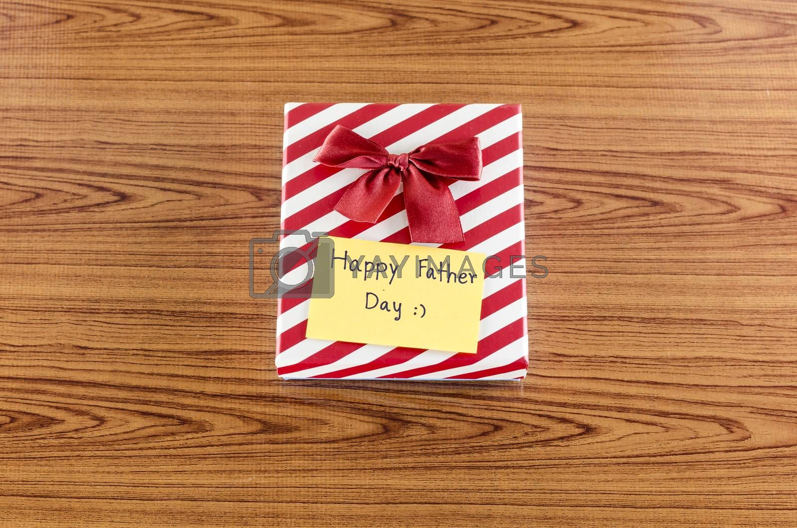 Royalty free image of gift box with card write happy father day by ammza12