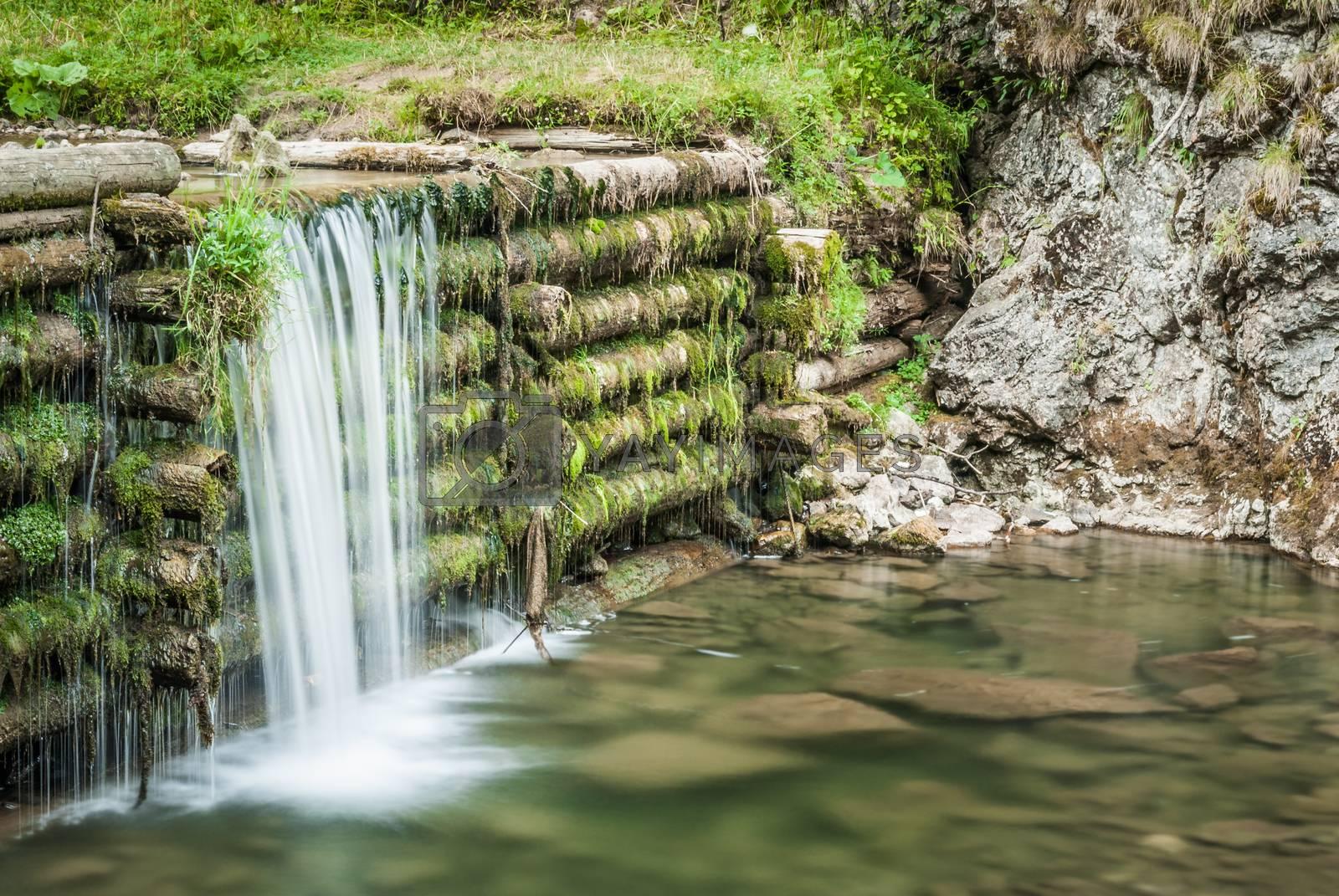 Royalty free image of man made waterfall by Kayco