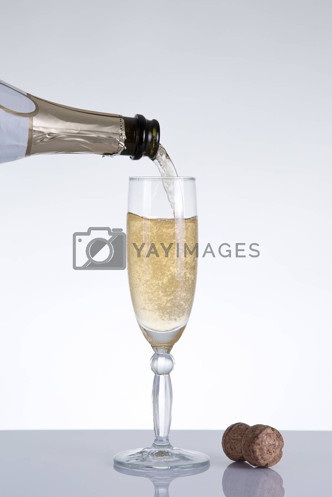 Royalty free image of Champagne pouring into an elegant glass  by Elisanth