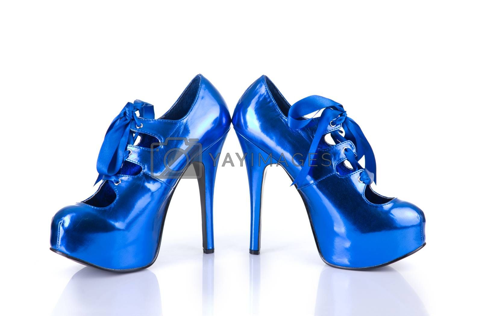 Elegant metallic blue female shoes, isolated on white background with natural reflection
