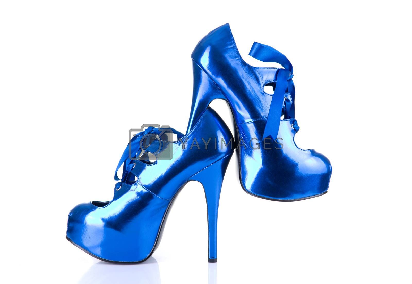 High heels metallic blue female shoes, isolated on white background with natural reflection