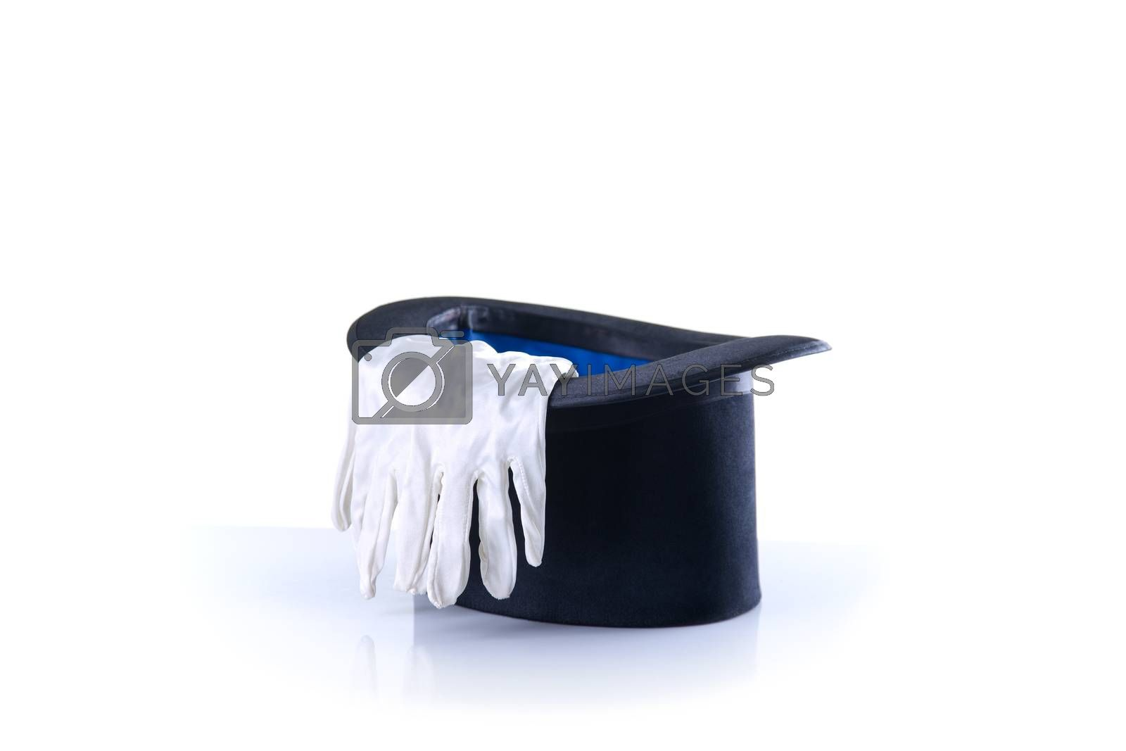 Black magician top hat with a pair of white gloves, isolated on white background