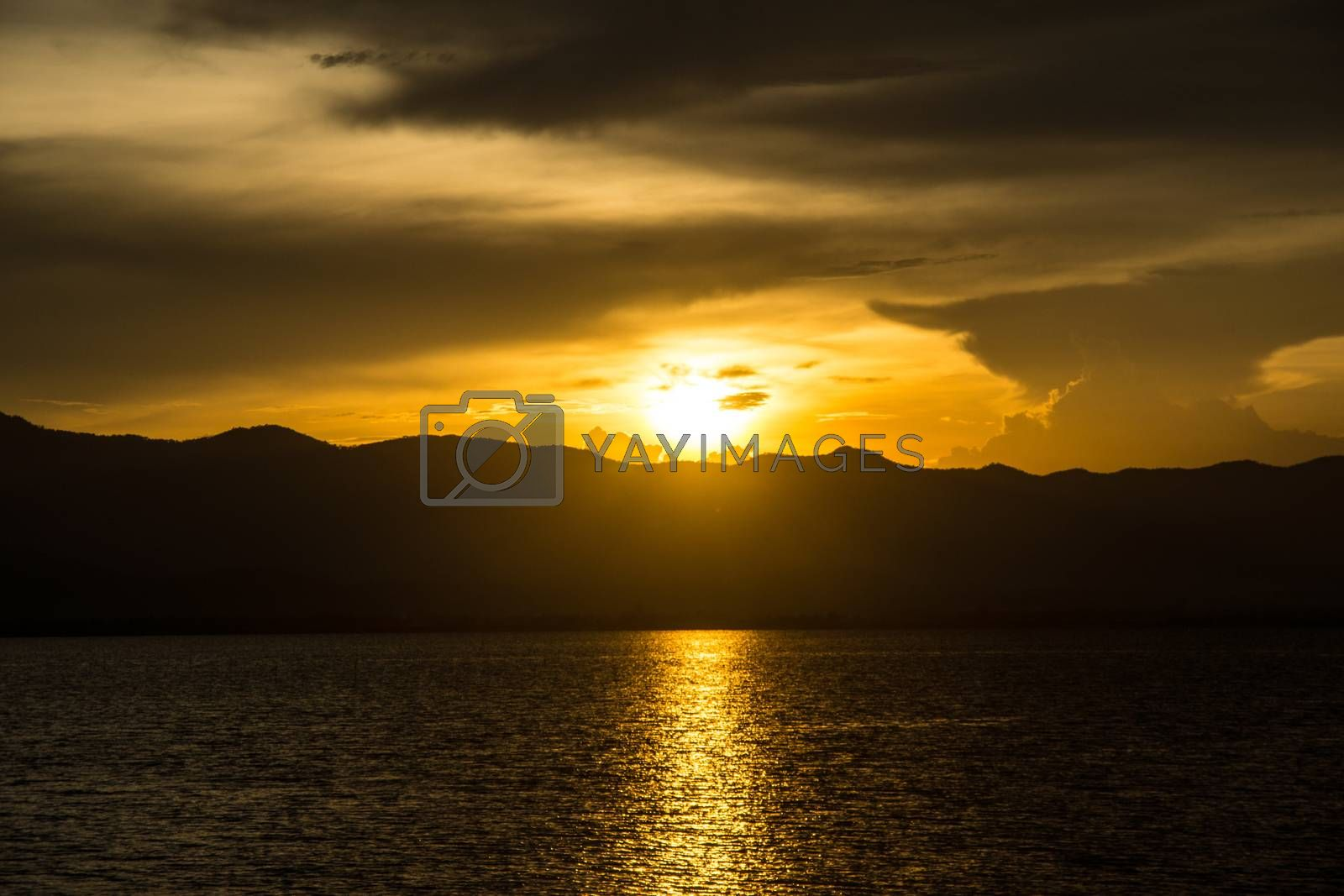 Royalty free image of sunset scene by nattapatt