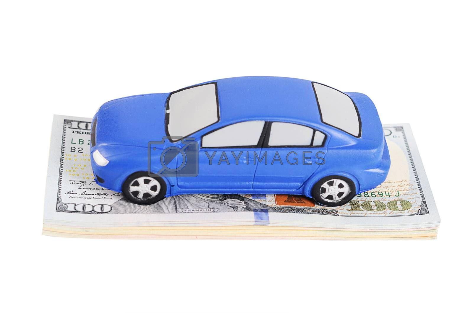 Royalty free image of Car model on dollar bills by SvetaVo