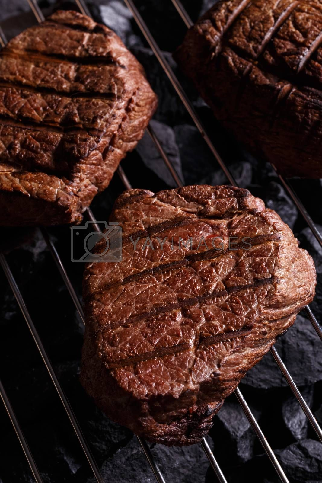 Royalty free image of Beef steak on a barbecue grill by primopiano
