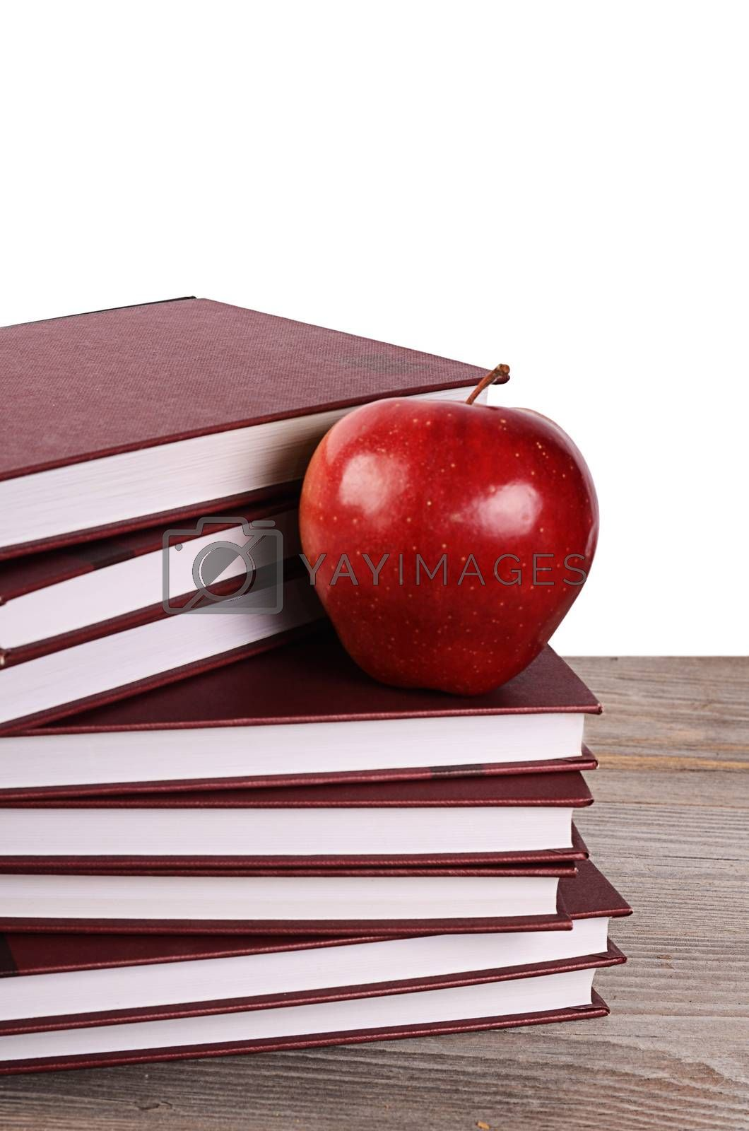 Royalty free image of Book with apple isolated on white by SvetaVo
