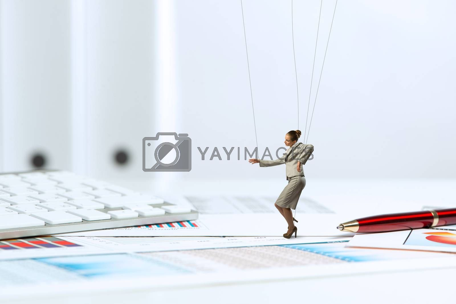 Royalty free image of businesswoman puppet doll is on the desk by adam121