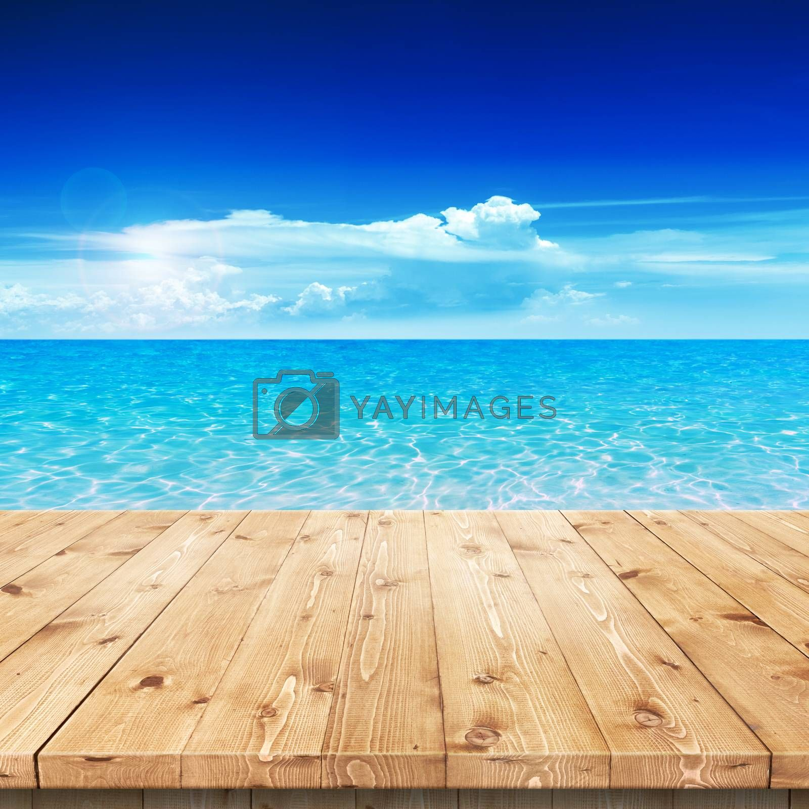 Royalty free image of Empty wooden table in a sun for product placement or montage by primopiano