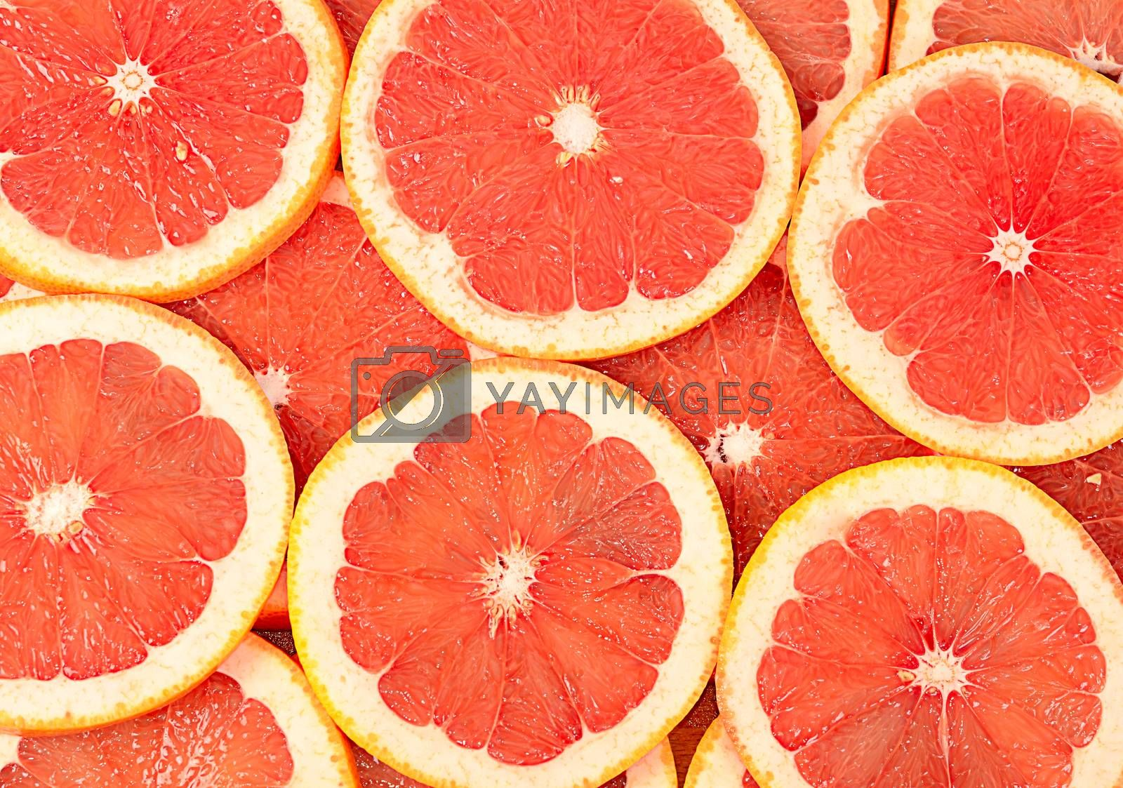 Royalty free image of Fresh grapefruit as a background by SvetaVo
