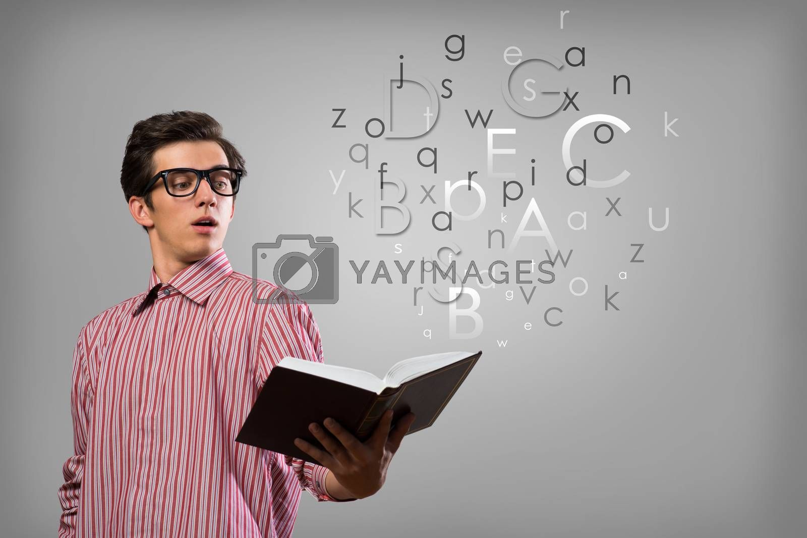 Royalty free image of young man scientist with book by adam121