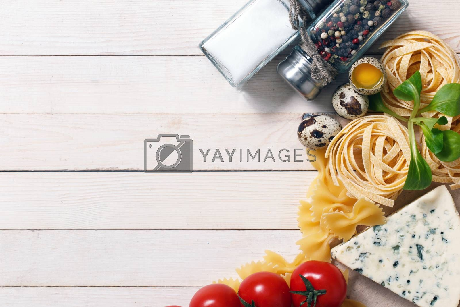 Royalty free image of Overhead view of ingredients for an Italian pasta recipe by primopiano
