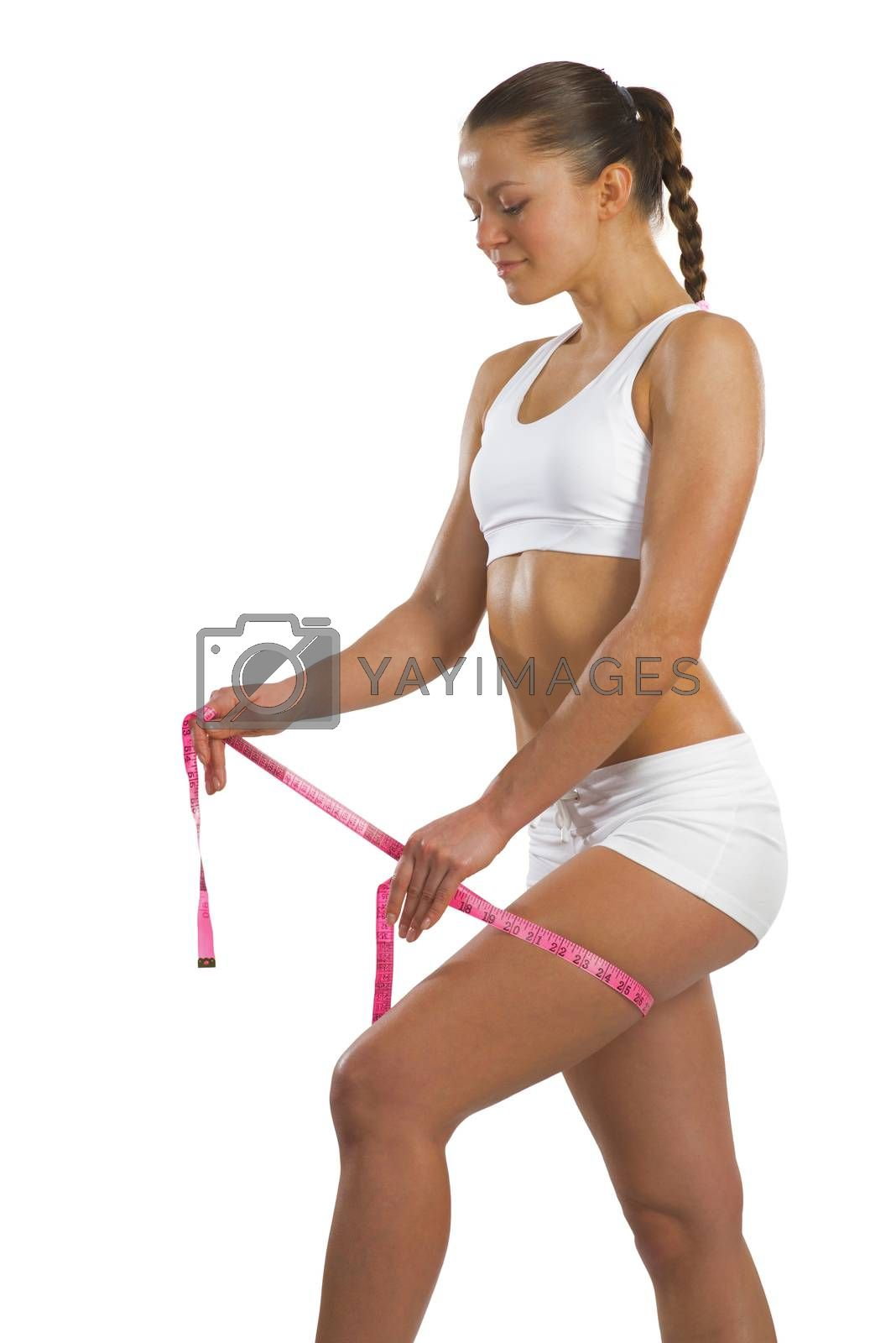 Royalty free image of athletic woman measuring thigh by adam121