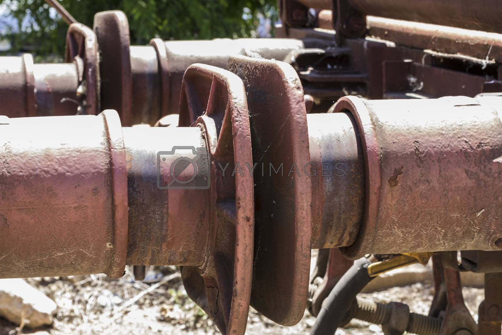 Royalty free image of old freight train, metal machinery details by FernandoCortes