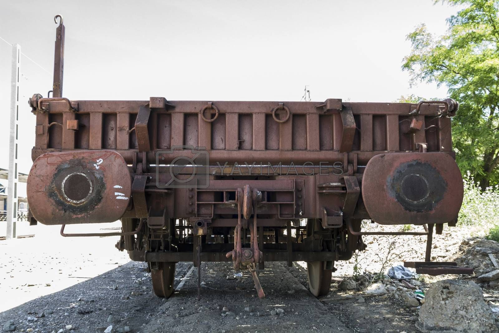 Royalty free image of railway, old freight train, metal machinery details by FernandoCortes