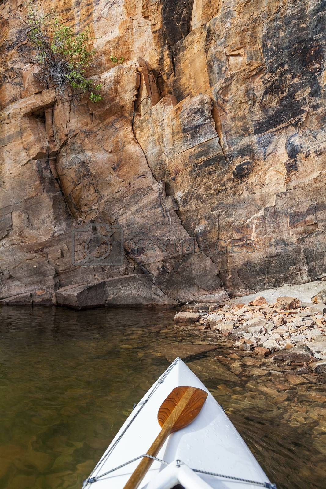 Royalty free image of canoe on a Colorado lake by PixelsAway