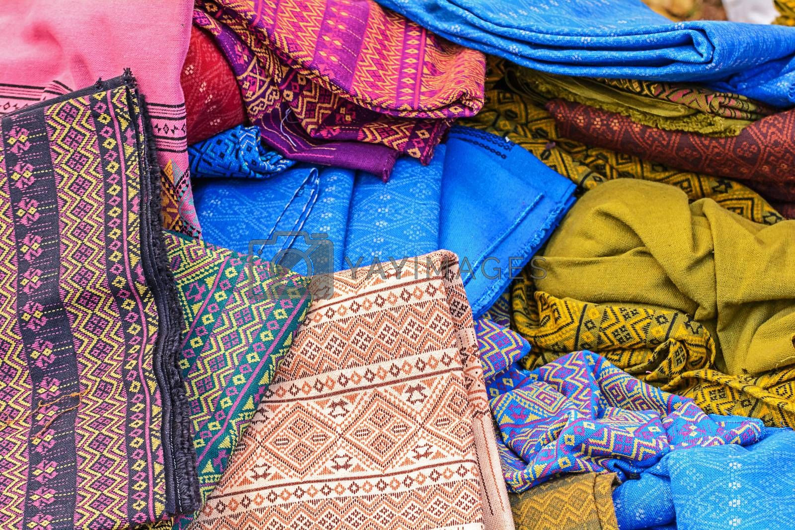 Royalty free image of stack of traditional sarong by NuwatPhoto