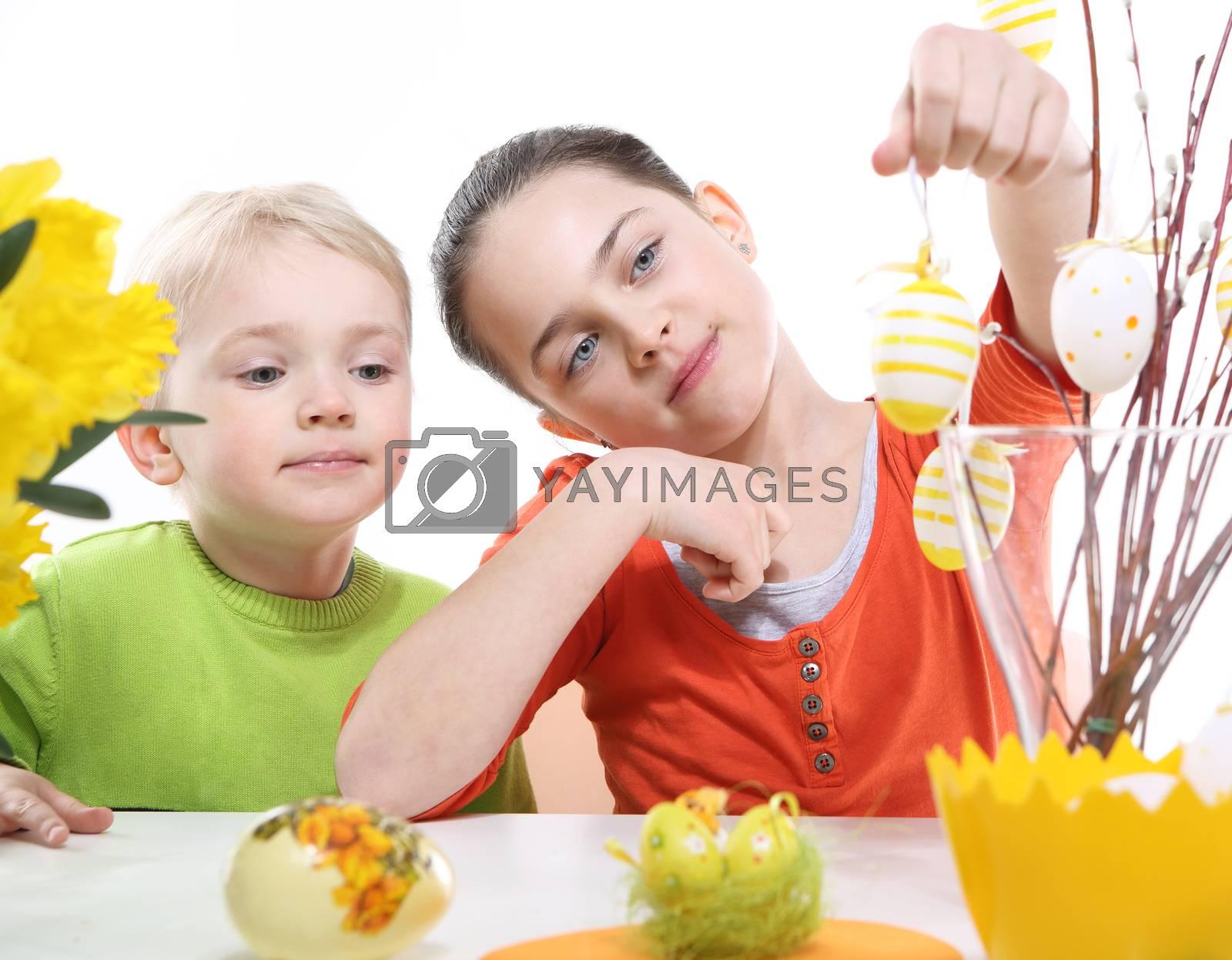 Family Easter- children decorates Easter eggs