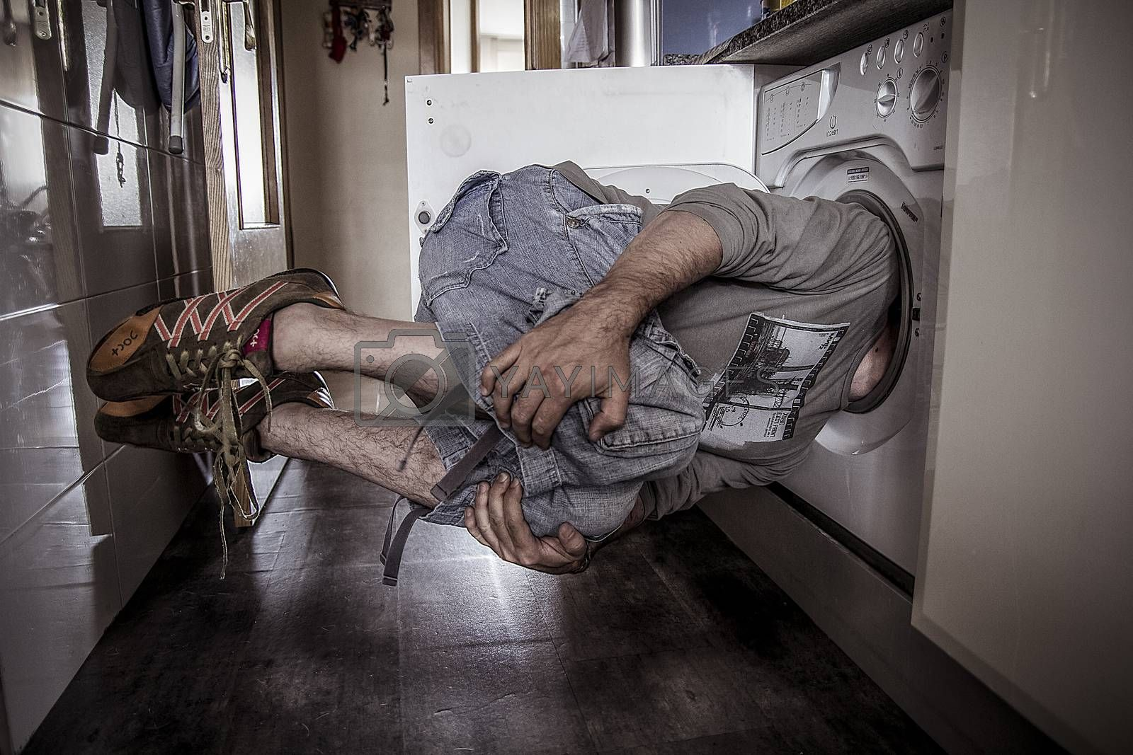 man flying with his head stuck in a washing machine