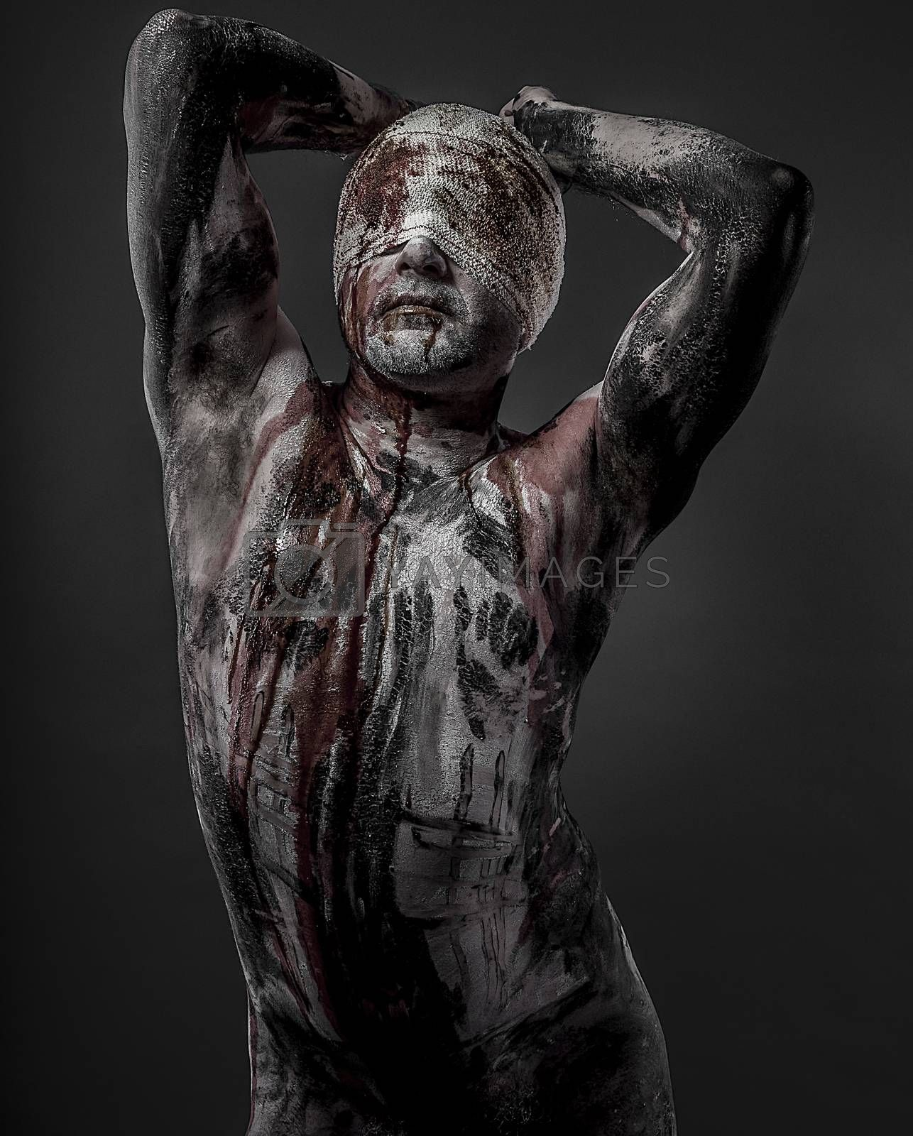 man with blood and blindfolded concept of prison, without freedom