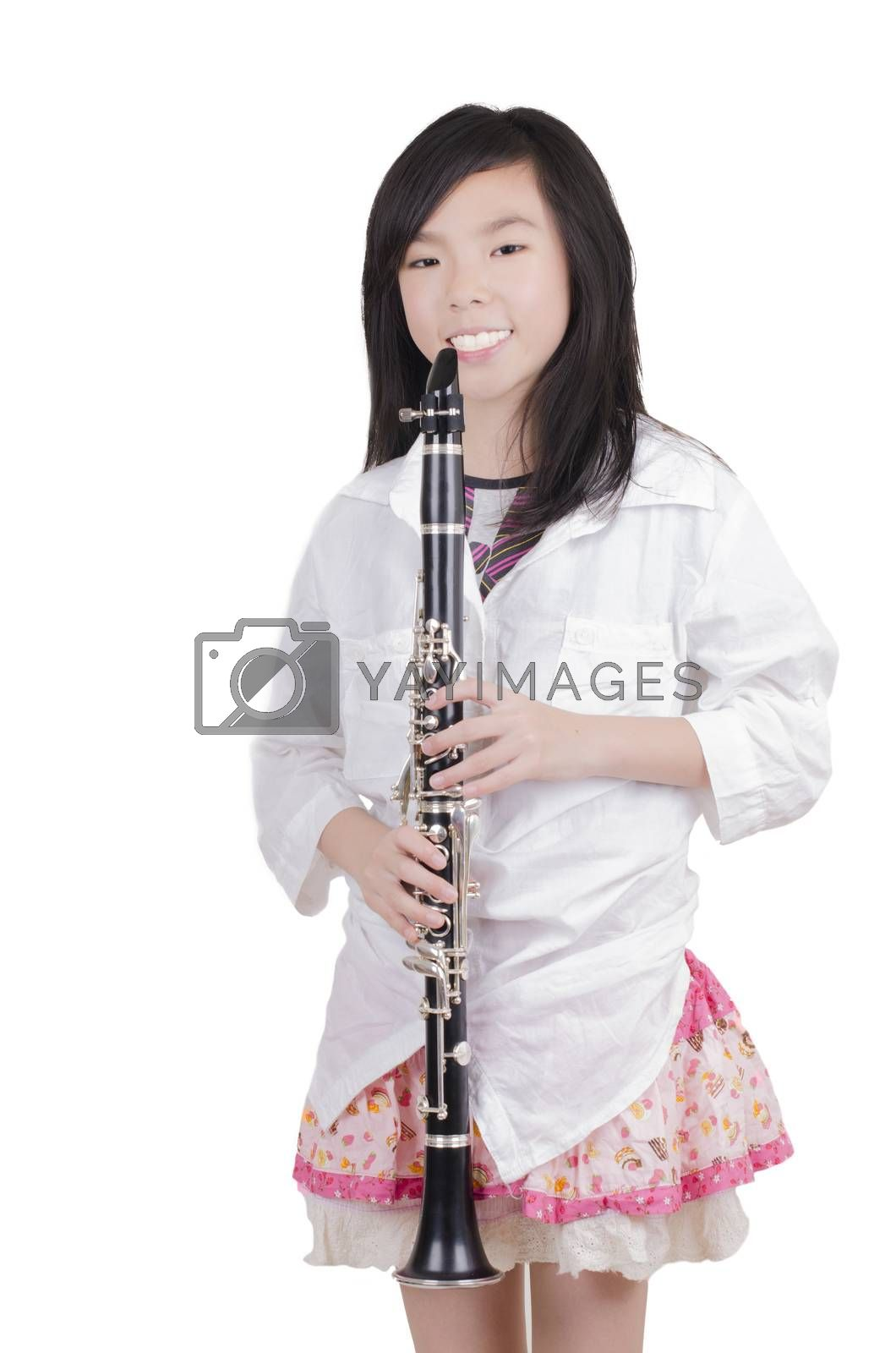 Royalty free image of Beauty girl blowing instrument by FrankyLiu