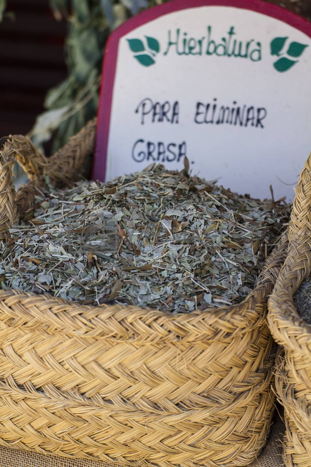 Healthcare, wicker baskets stuffed medicinal healing herbs