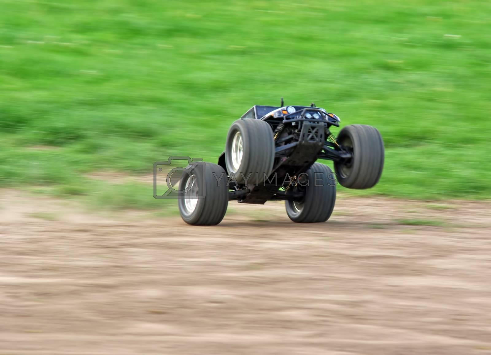 Powerfull radio controlled car speeding on the grass