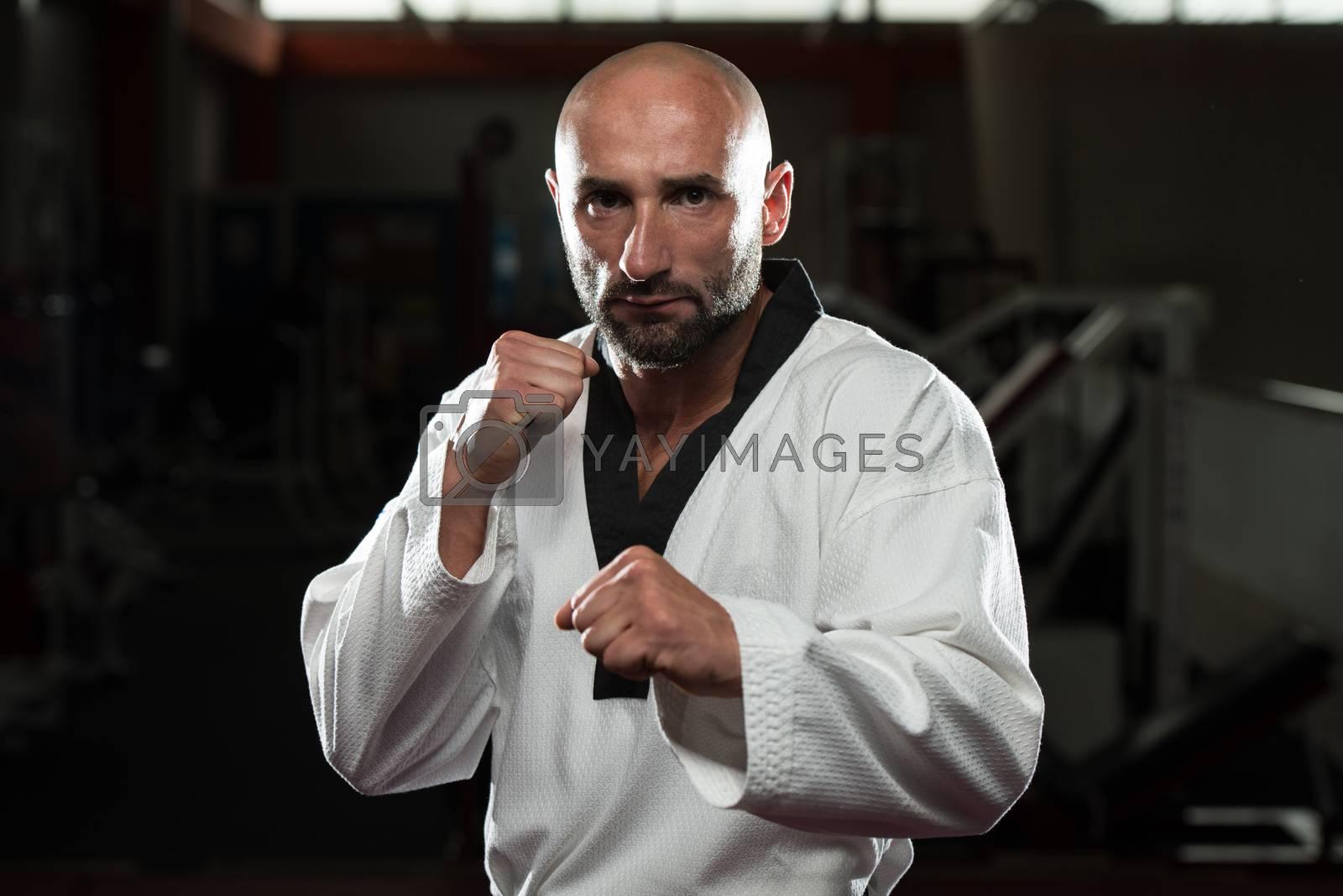 Mature Man Practicing His Karate Moves