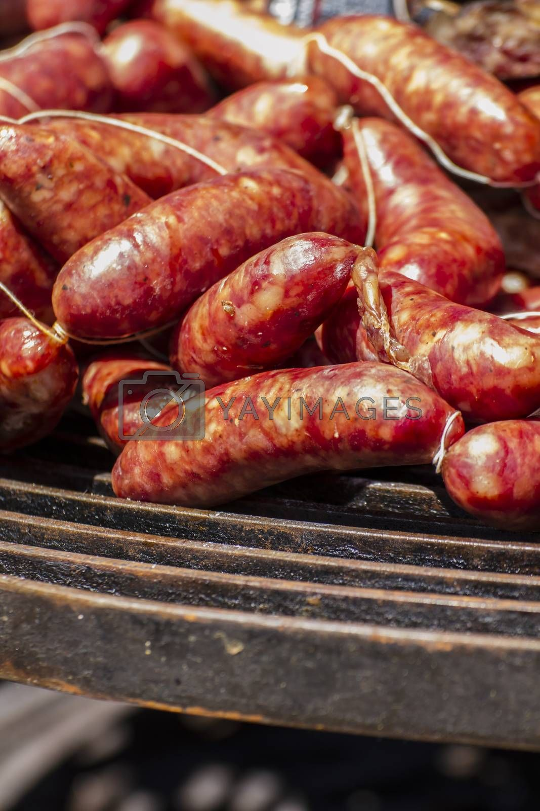 Barbecue, artisan sausages in a medieval fair