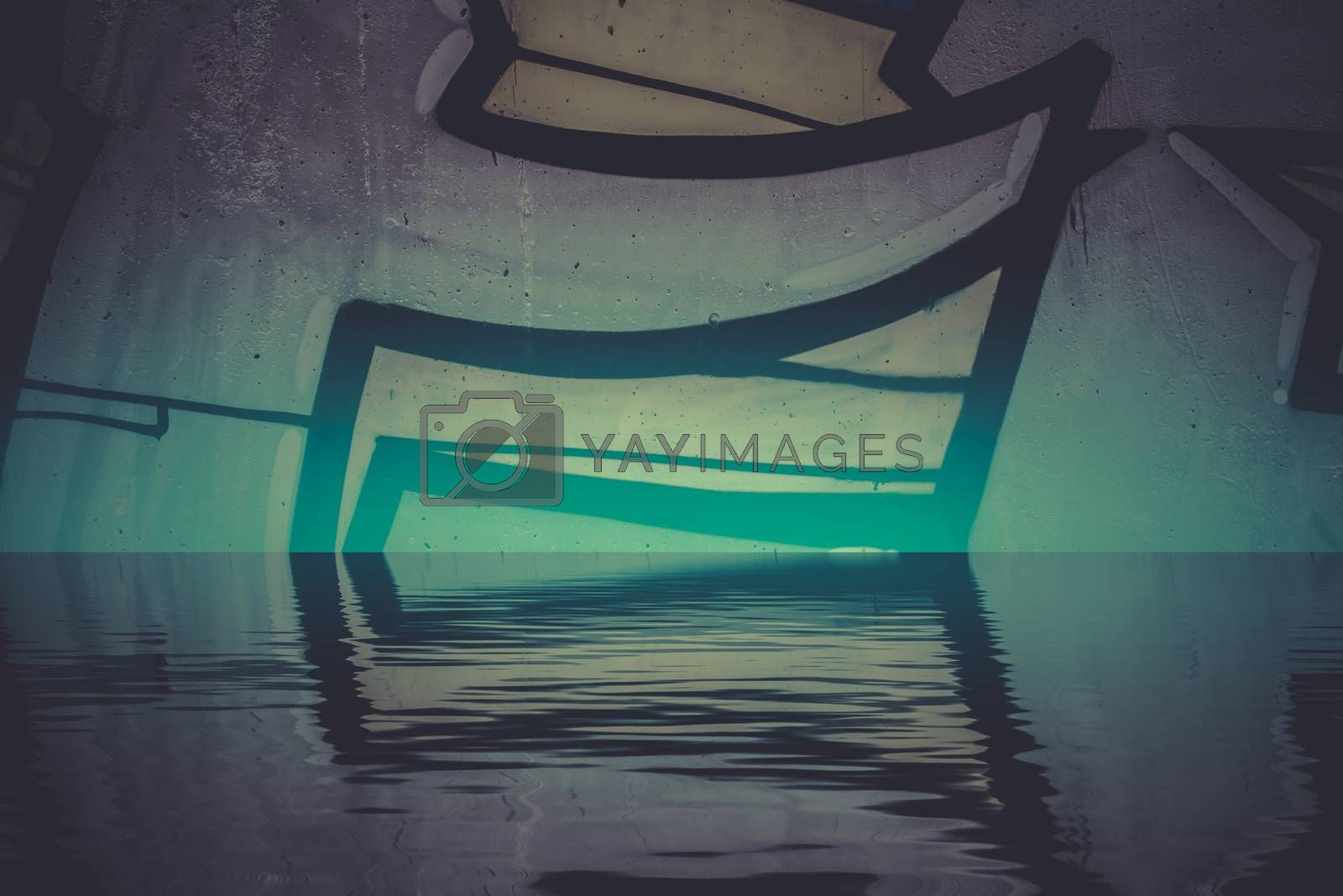 Graffiti wall texture reflection in  water, artistic urban picture