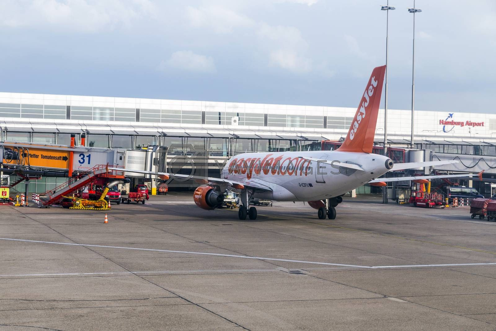 HAMBURG, GERMANY - MAY 22, 2014: Aircrafts at the gate in the modern Terminal 2  in Hamburg, Germany. Terminal 2 was completed in 1993 and houses Lufthansa and other Star Alliance partners.