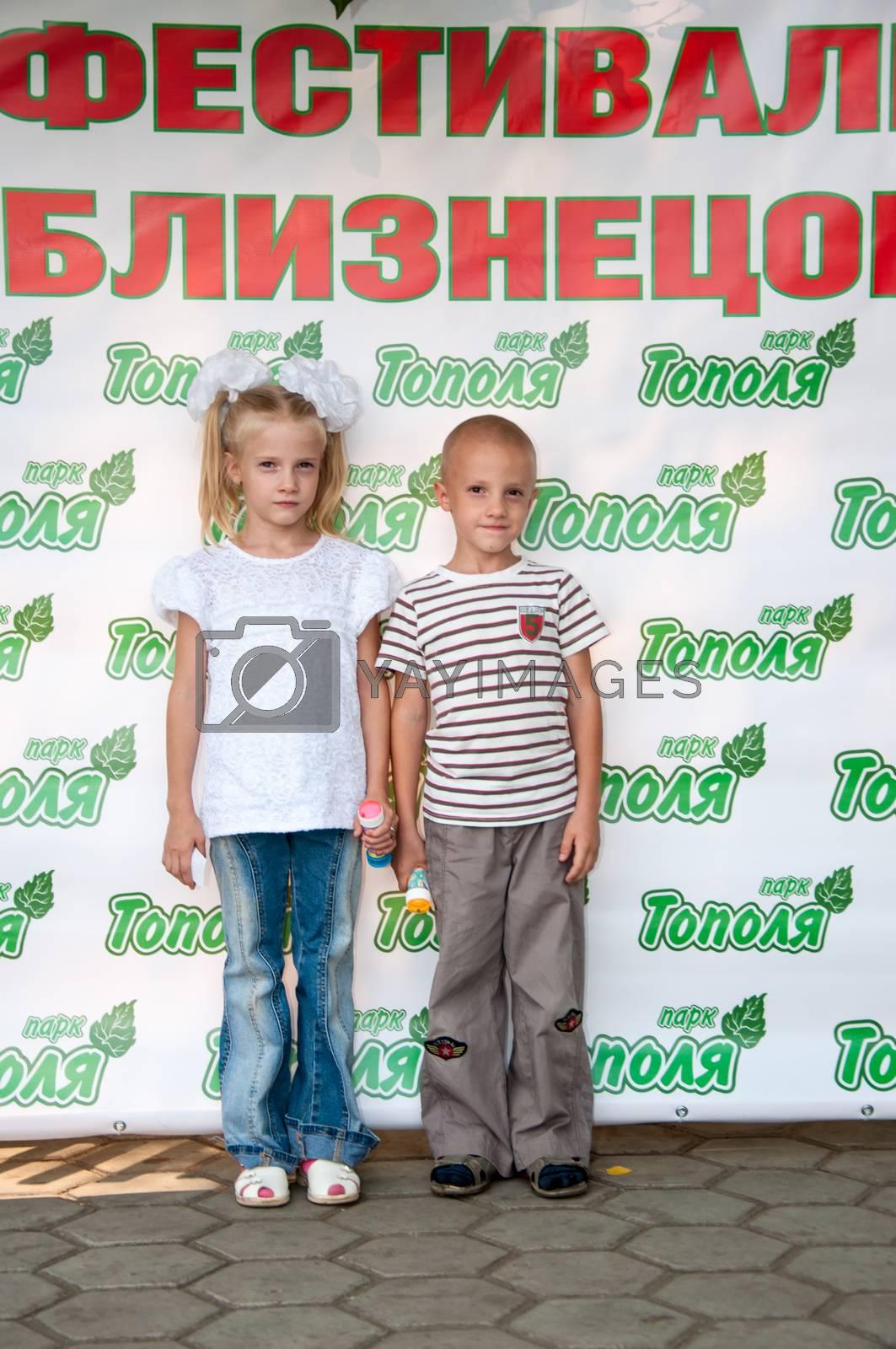 The city of Orenburg, Orenburg oblast, Russia, August 11, 2013. Festival of twins in the City Park of Poplar. http://park-topolya.ru/