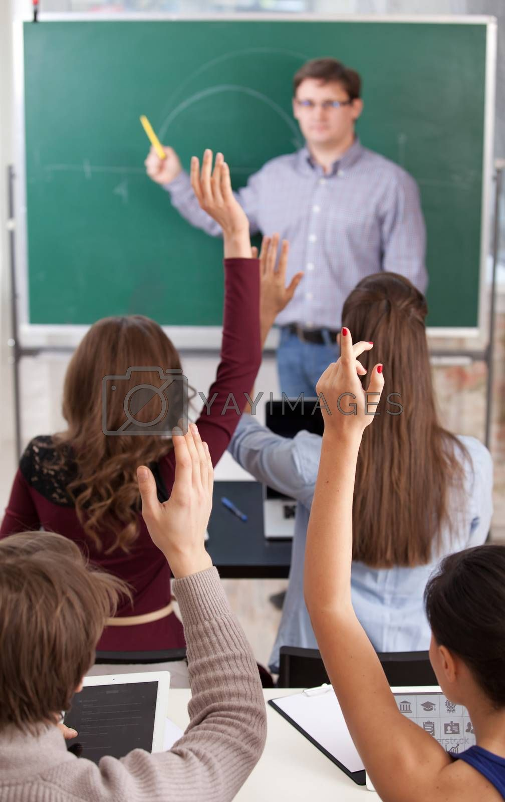 colledge students in classroom at lesson