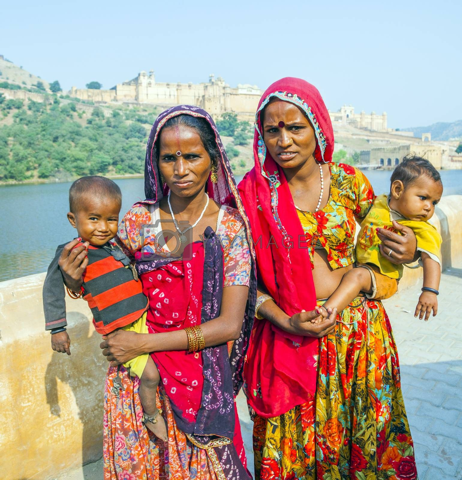 JAIPUR, INDIA - OCTOBER 19, 2012: women beg for money with her 1 year old children in arm in Jaipur, India. Begging with babies is popular at touristic spots.