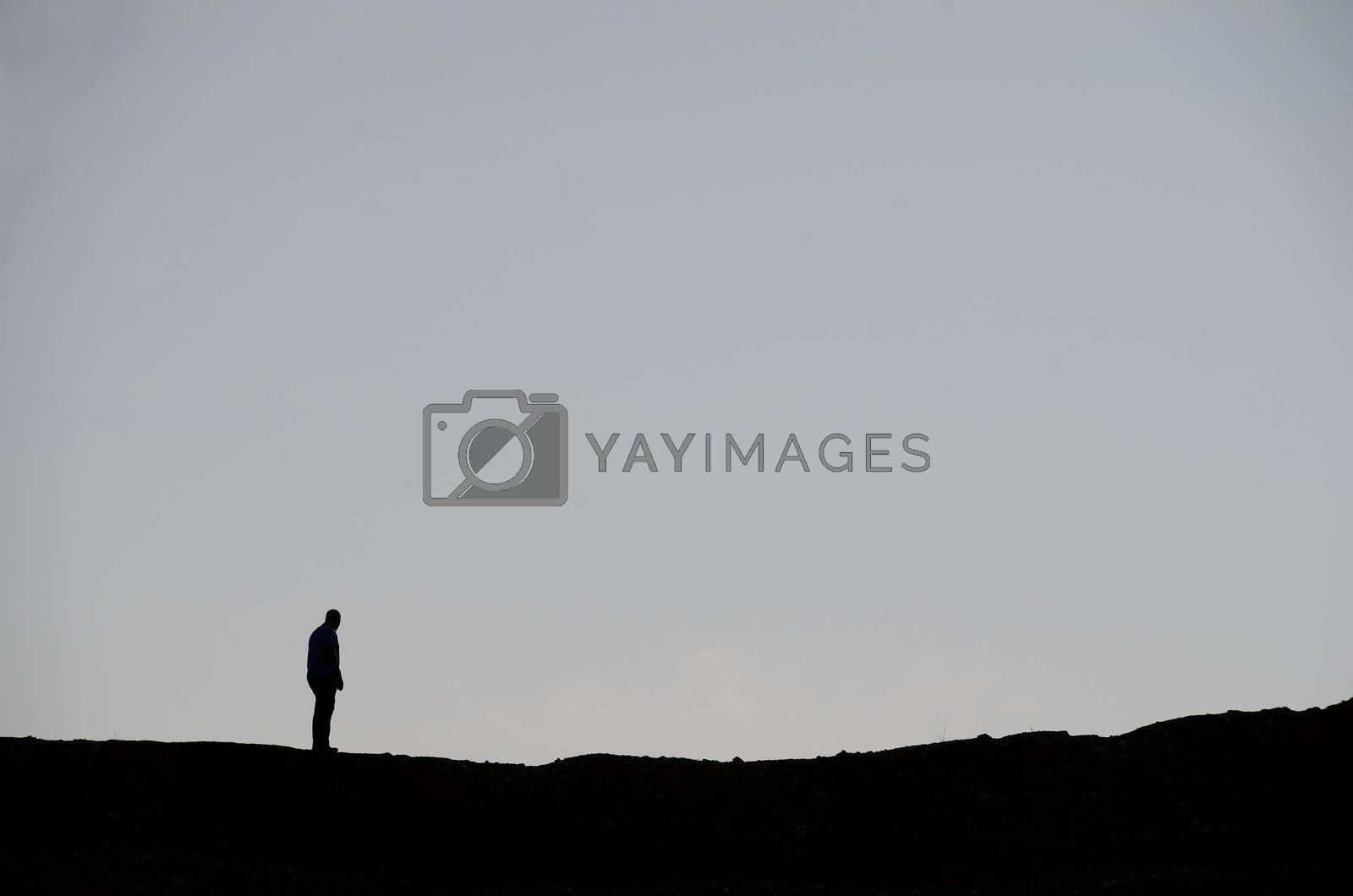 man standing while hiking in the summer
